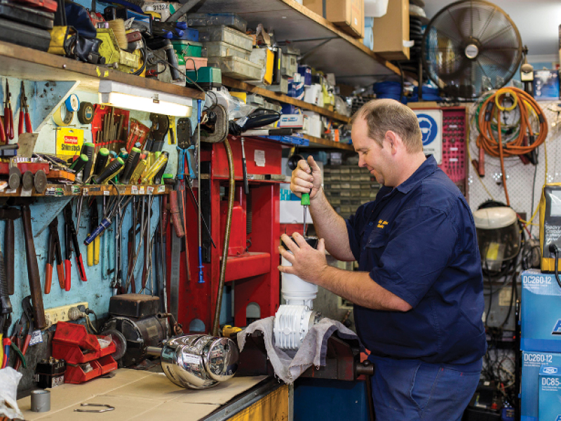 Staff member working in Airlie Marine Electrics at Coral Sea Marina