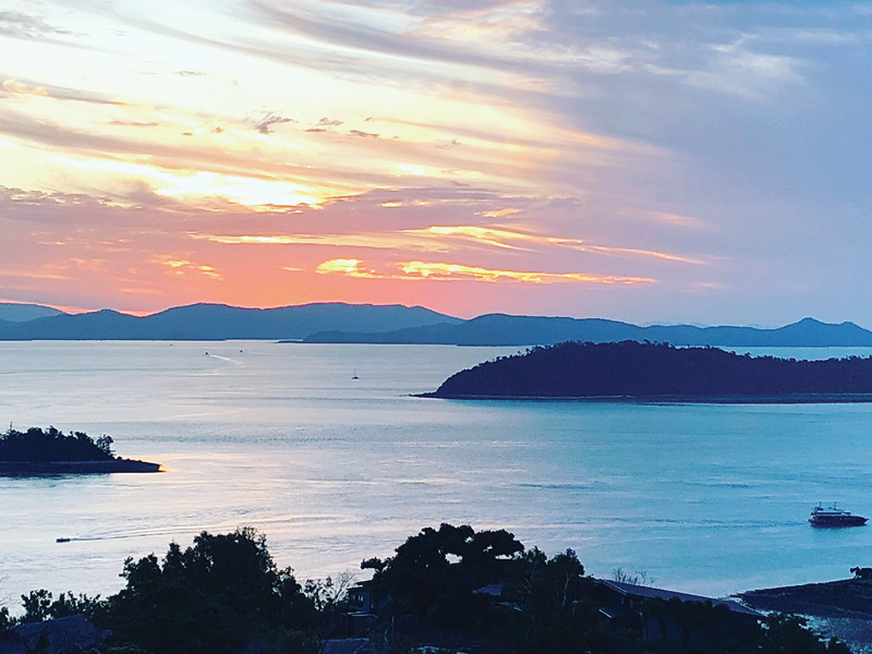 View of sunset over Whitsunday Islands from One Tree Hill on Hamilton Island