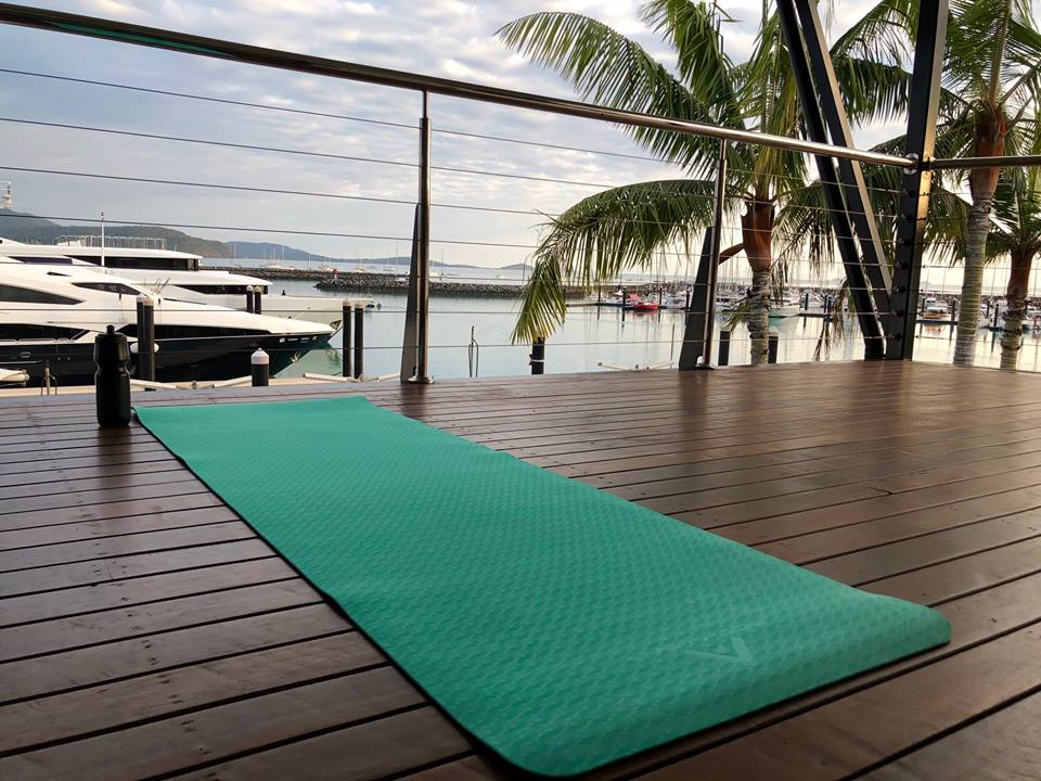 A yoga mat on the balcony at The Lookout over looking Coral Sea Marina