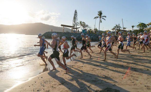 Airlie Beach Triathlon 2017 attendees entering the water at Airlie Beach lagoon beach