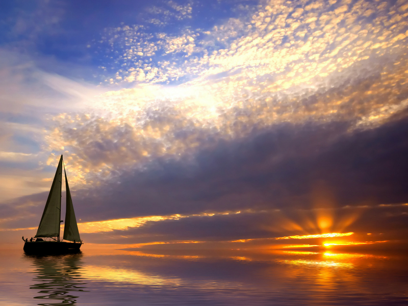 A sailing vessel at sunset in the Whitsundays