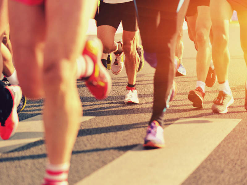 Close up image of legs running during a marathon