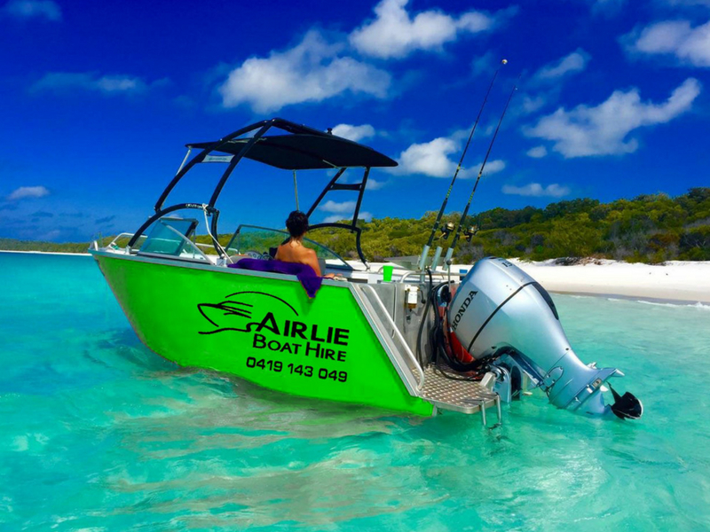 Airlie Boat Hire green vessel at Whitehaven Beach in the Whitsundays