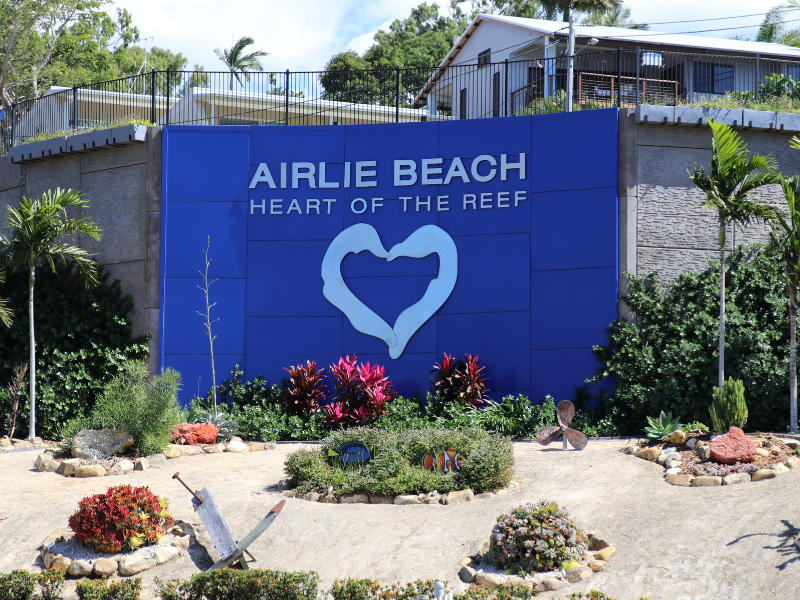 Airlie Beach Heart of the Reef sign on main street of Airlie Beach