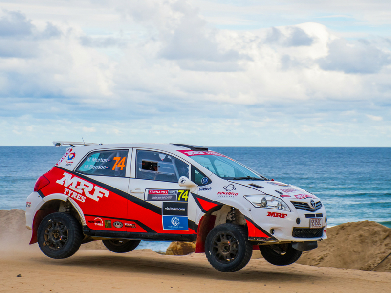 Whitsunday Festival of Motoring rally car during race next to ocean
