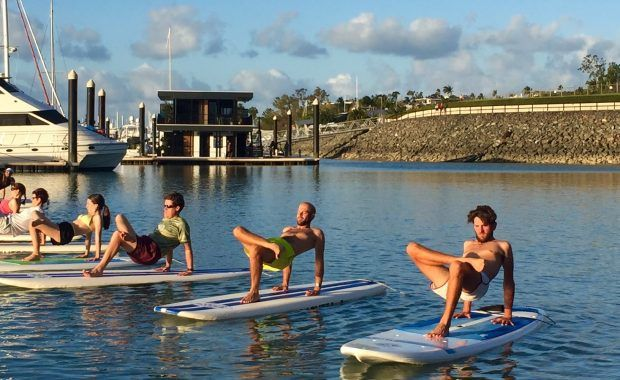 Stand Up Paddle Board yoga class at Coral Sea Marina