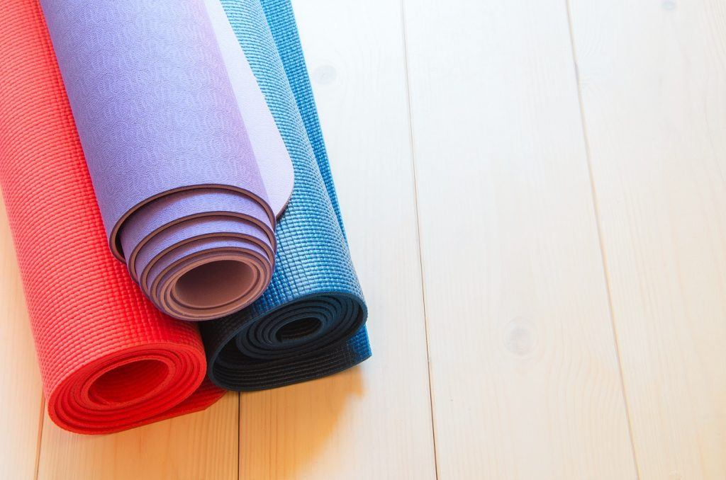 Yoga mats rolled up