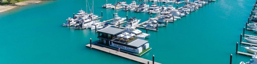 An aerial image of the floating Ocean Club at the north marina at Coral Sea Marina