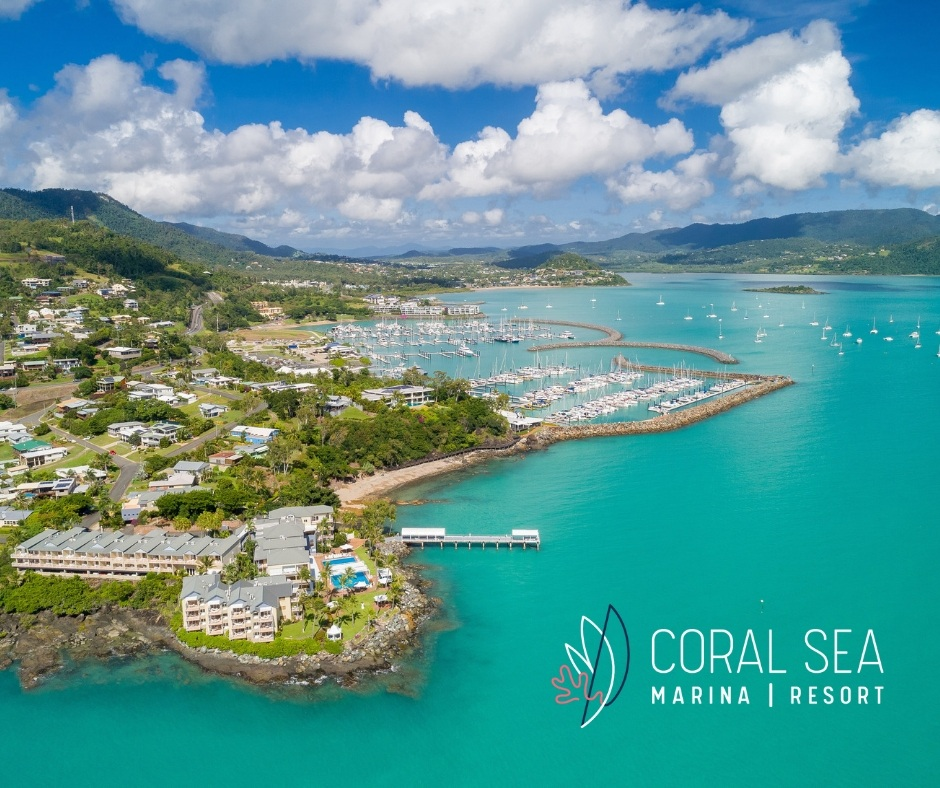 An aerial image of the Coral Sea Marina Resort and the Whitsundays mainland coastline