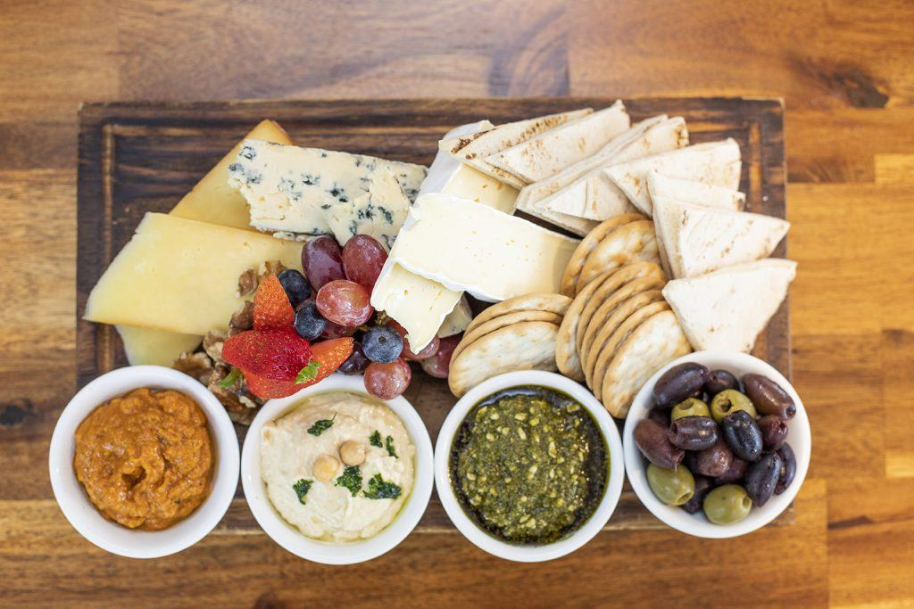 share platter of cheeses, dips and fruits at The Garden Bar Bistro