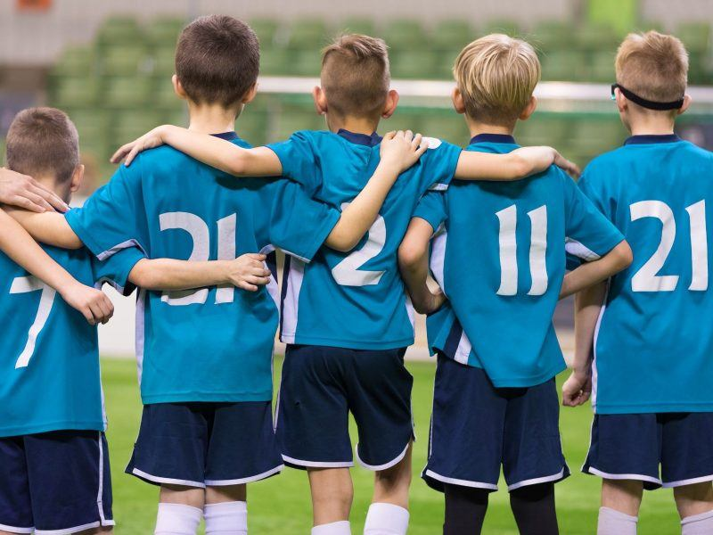 A junior soccer team lined up for a penality