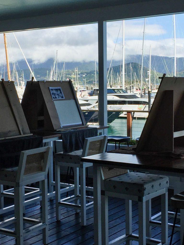 An art class set up at The Garden Bar Bistro at the Coral Sea Marina