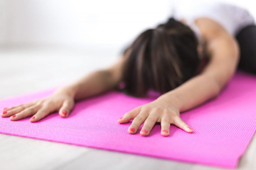 Woman Exercising on Yoga Mat