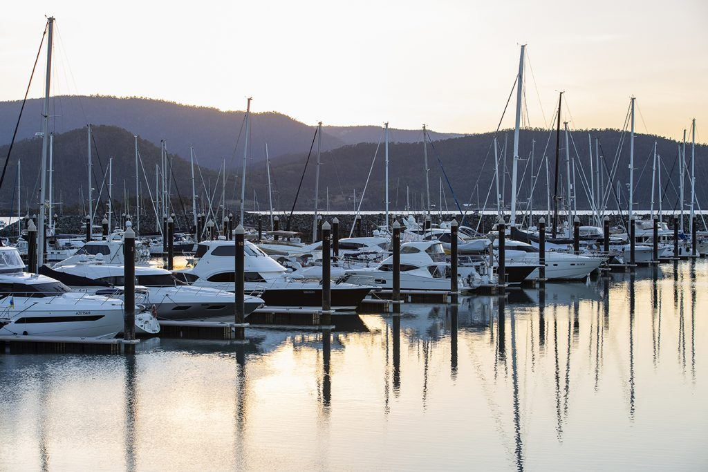 Sunset over the Coral Sea Marina with yachts in berths