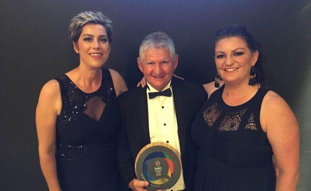 Staff members of Cumberland Yacht Charters holding their Gold Winner trophy at the 2019 Queensland Tourism Awards