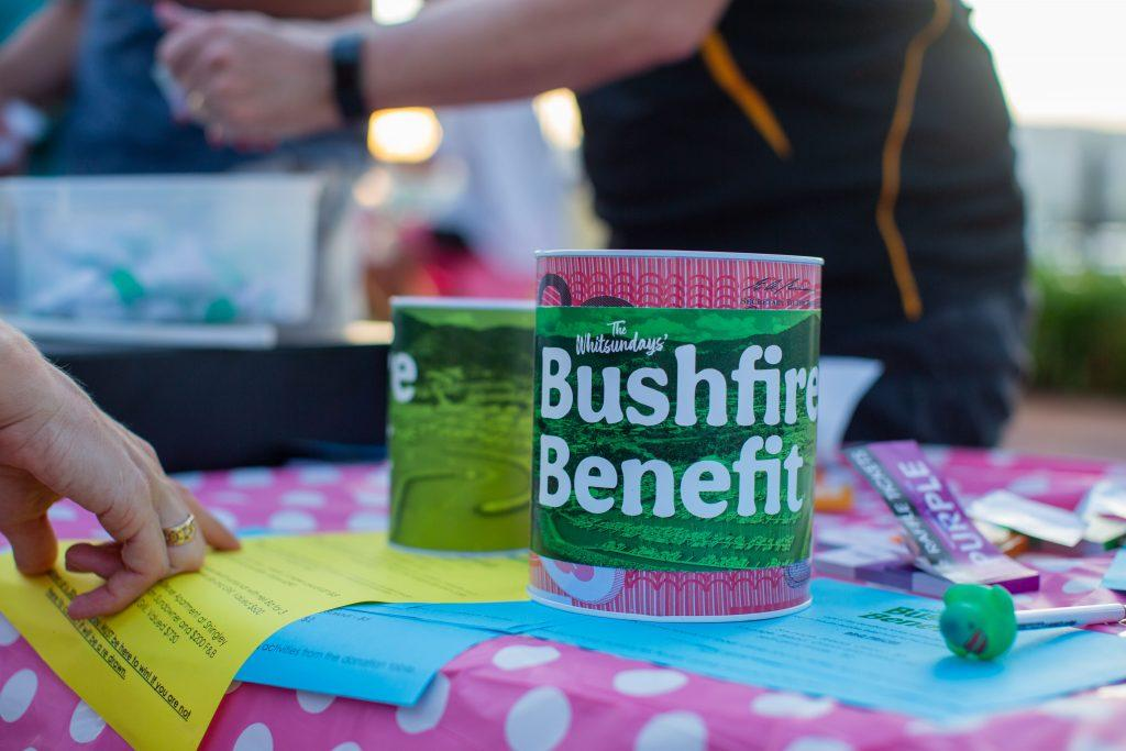 A collection tin on a table at the Whitsundays Bushfire Benefit