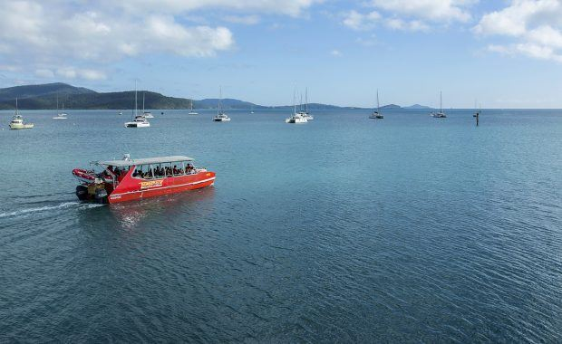 Red Cat Adventures' vessel Thundercat leaving Coral Sea Marina on a day trip to the Whitsunday islands