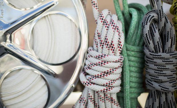 Sailing vessel lines coiled and tied to stanchion on vessel