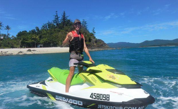 Man on jetski on the Whitsunday Jetski Tours in front of Daydream Island