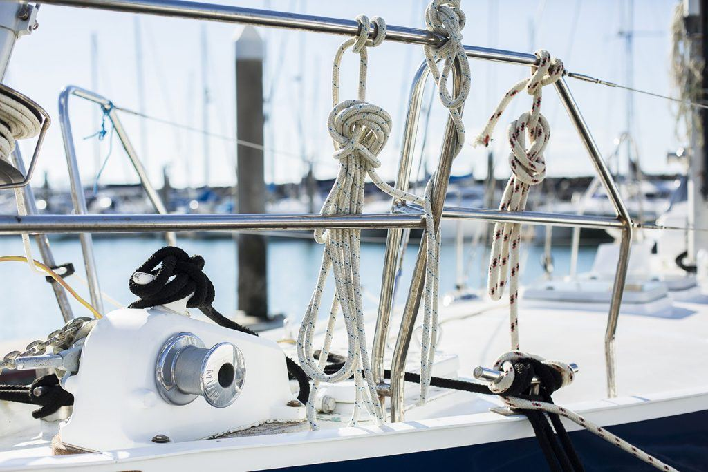 Winches and lines on the deck of a yacht