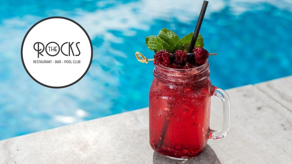 Refreshing cocktail by the pool at The Rocks, Restaurant Bar and Cafe at the Coral Sea Resort Hotel