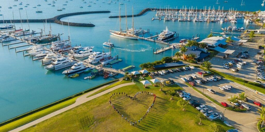 Group of Coral Sea Marina Resort tenants, operators and staff creating the image of a heart in the Coral Sea Marina Gardens