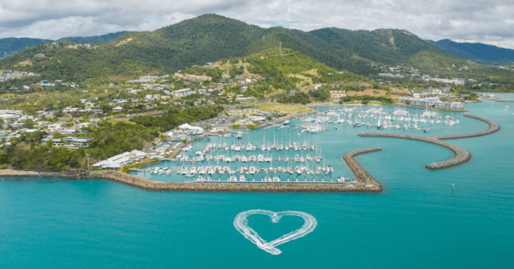 A heart made from two jet ski wakes in the water outside the Coral Sea Marina in the Whitsundays