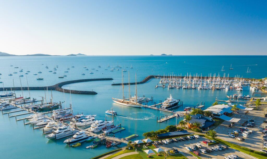 Aerial image of Coral Sea Marina Resort in the Whitsundays with superyacht Adix featured