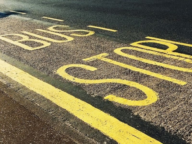 Bus Stop signage on the concrete road
