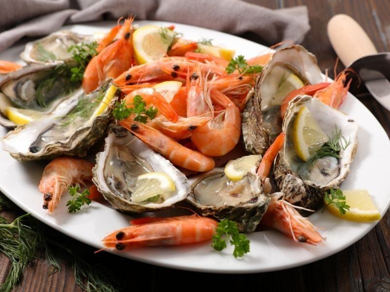 Fresh seafood platter including prawns and natural oysters