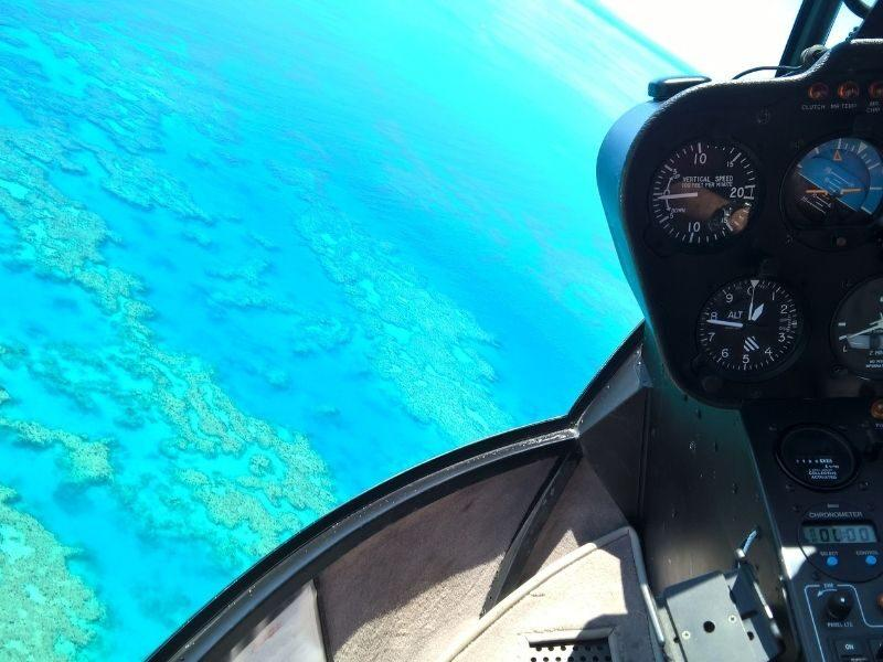 Helicopter flying over the Great Barrier Reef in the Whitsundays