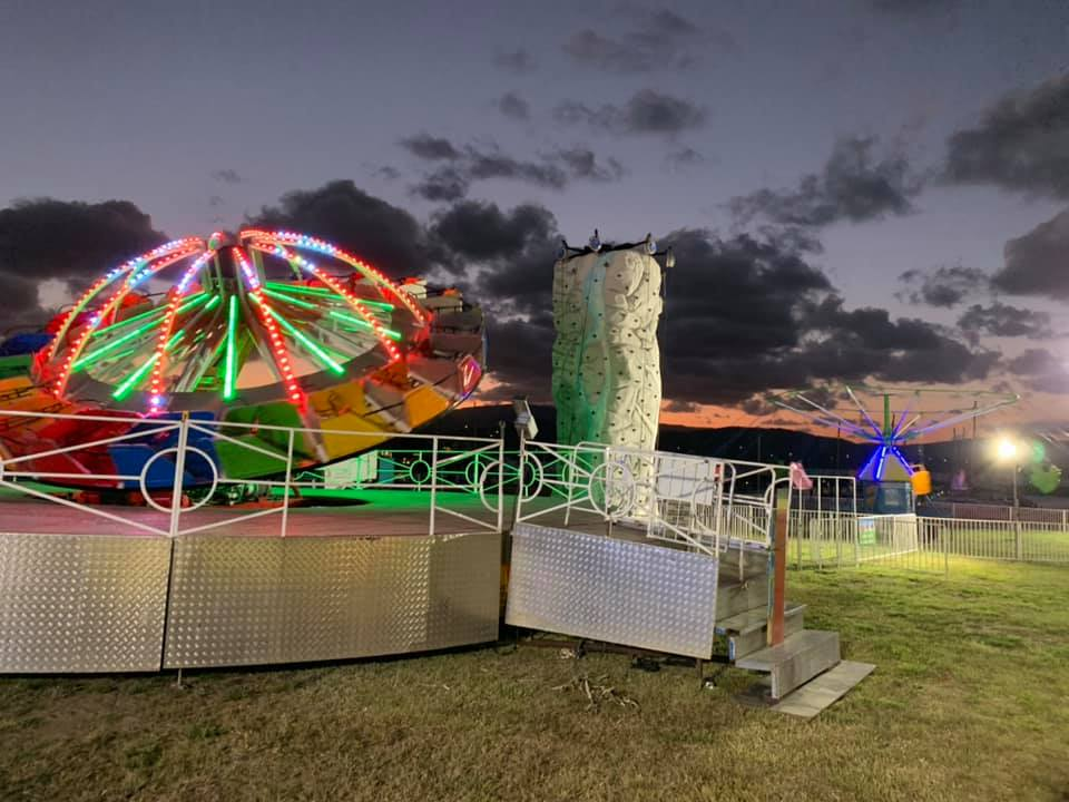 Airlie Beach Family Carnival fairground rides at Coral Sea Marina at night