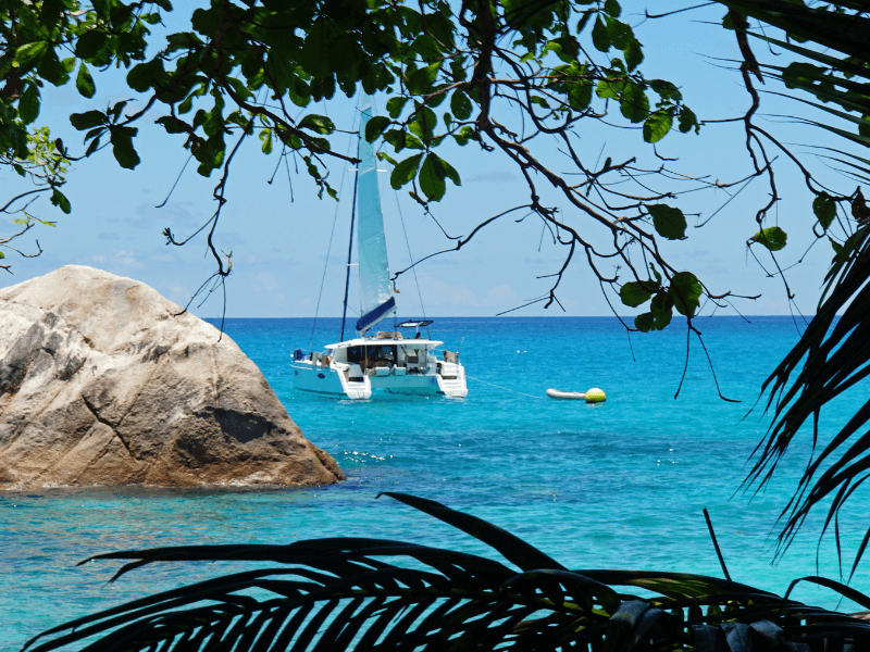 catamaran anchored in secluded bay