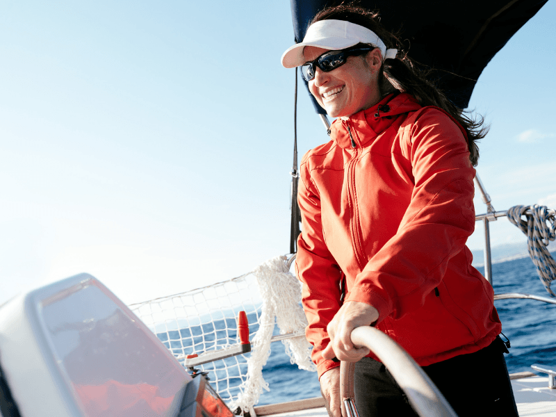 women sailing yacht in red jacket