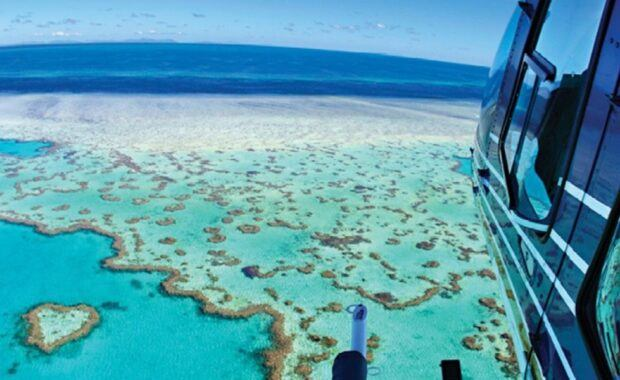 Helicopter flying over Heart Reef on the Great Barrier Reef