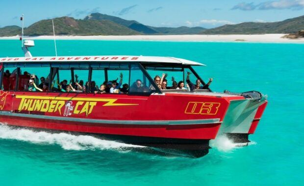 Thundercat speed catamaran from Red Cat Adventures in the Whitsundays on bright blue water