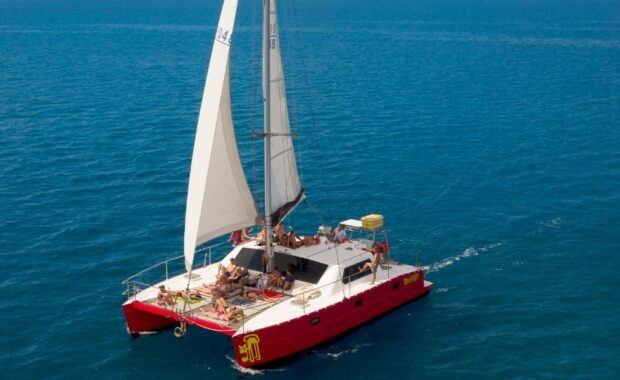 Red Sailing Vessel, Tongarra, sailing in the Whisundays