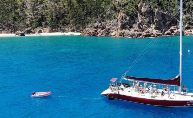 Sailing maxi yacht, Siska, anchored in a bay in the Whitsunday Islands