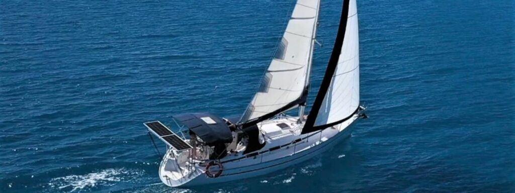 Sailing monohull under sail in the Whitsundays