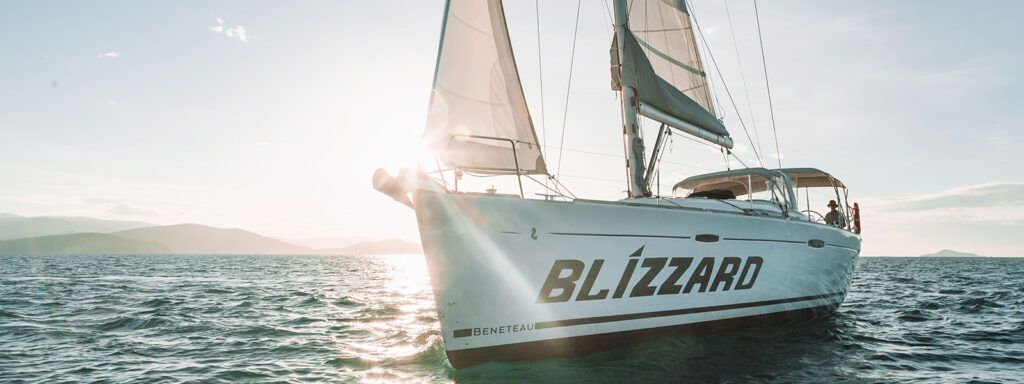 Sailing monohull vessel, Blizzard, under sail at Sunset