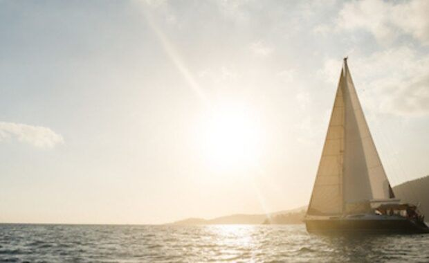 Sailing vessel in the Whitsundays at sunset