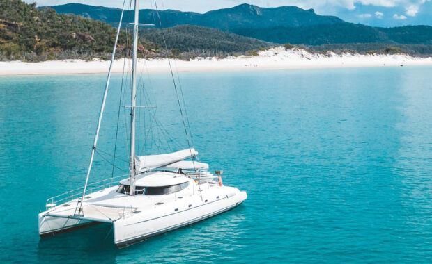 Sailing catamaran, Entice, anchored at Whitehaven Beach in the Whitsundays