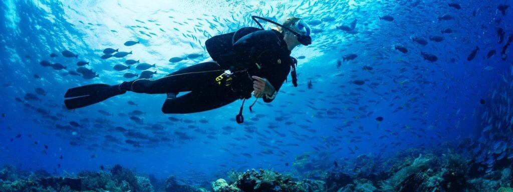 A woman scuba diving on the Great Barrier Reef
