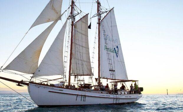 Tall Ship sailing at Sunset