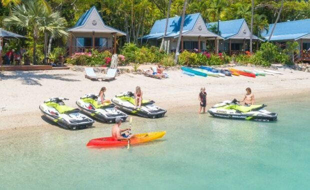 A group of people and Jet Skis at Palm Bay Resort, Long Island in the Whitsundays