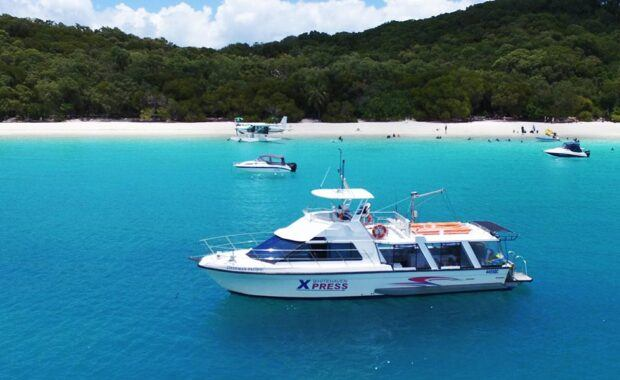 Whitehaven Xpress motor vessel moored up in front of Whitehaven Beach, Whitsundays