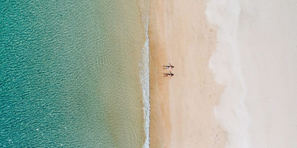 A couple on a beach enjoying some Rest and Relaxation