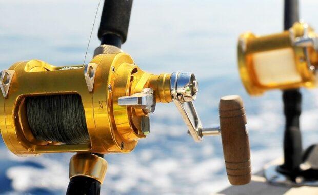 Two fishing reels on board a vessel on the ocean