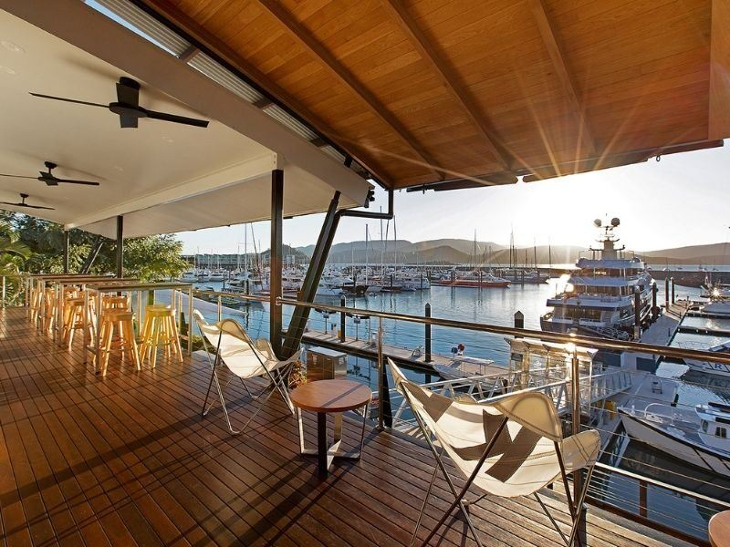 The view from the balcony of The Lookout Lounge at Coral Sea Marina in the Whitsundays, at sunset with superyachts