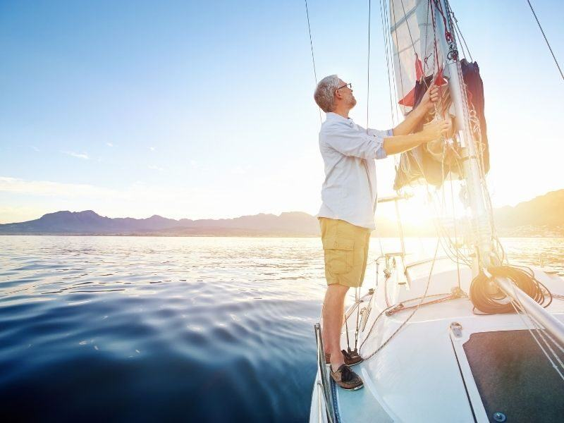A man on a sailing yacht at the mast